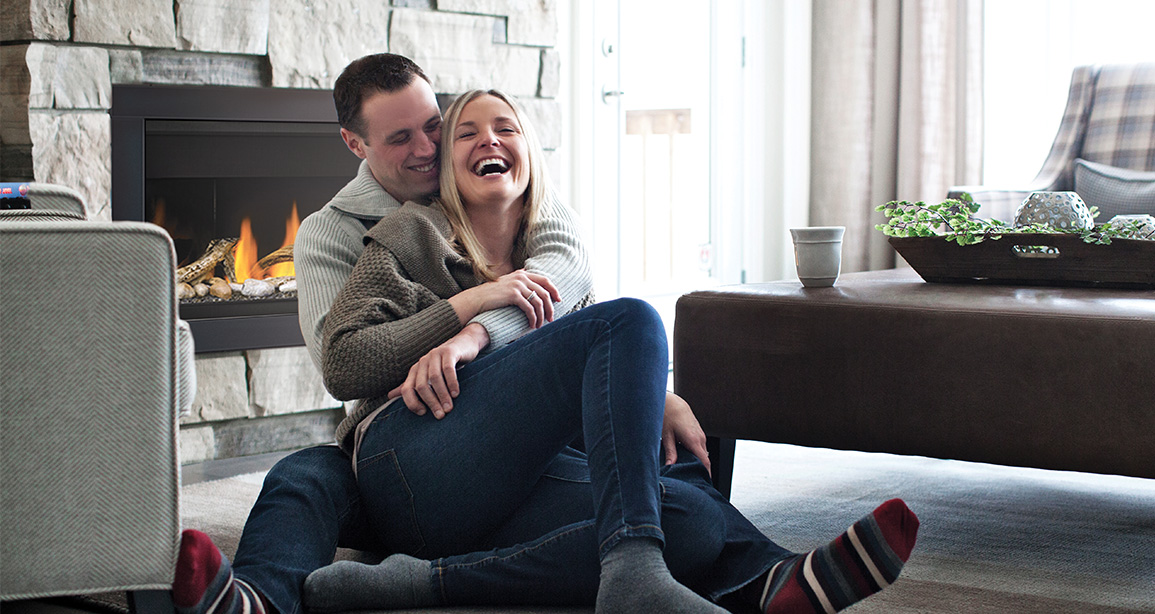 Couple Laughing in Front of a fire | Mountain House at Windfall | Blue Mountain, Ontario