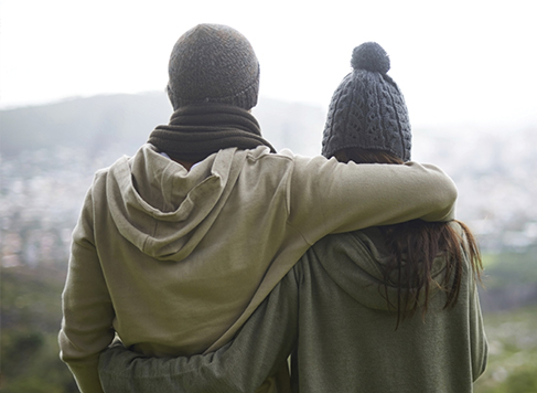 Couple on a mountain wearing sweaters and touqes | Mountain House at Windfall | Blue Mountain Ontario